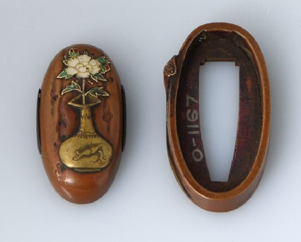 Fuchi and kashira with lotus pod and peonyfront