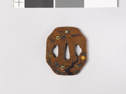 Octagonal tsuba with plum tree and ground bamboofront