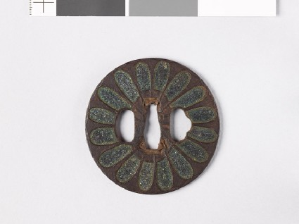 Tsuba with chrysanthemoid florets and sword-bladesfront