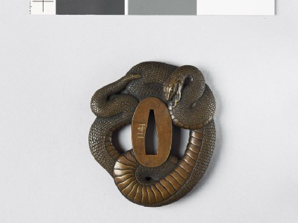 Tsuba in the form of a coiled snakefront