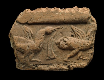 Fragment of a tile with ducksfront