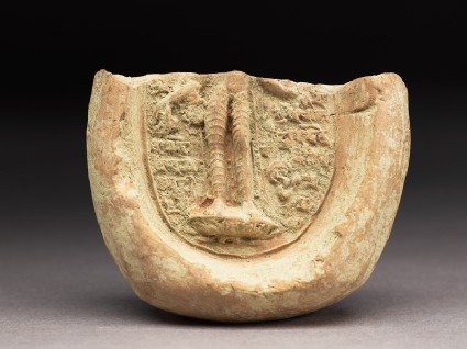 Fragment of a votive plaque with standing figurefront