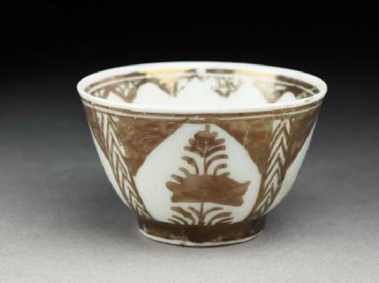 Cup with lustre decorationoblique