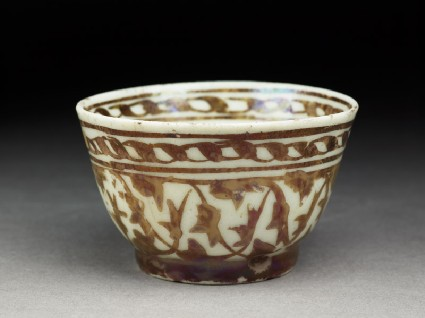 Cup with lustre decorationoblique