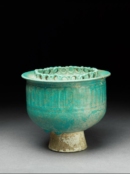 Cup with pierced decoration and small mouthoblique