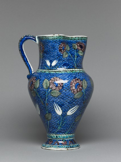 Jug with flowers against a fish-scale backgroundside
