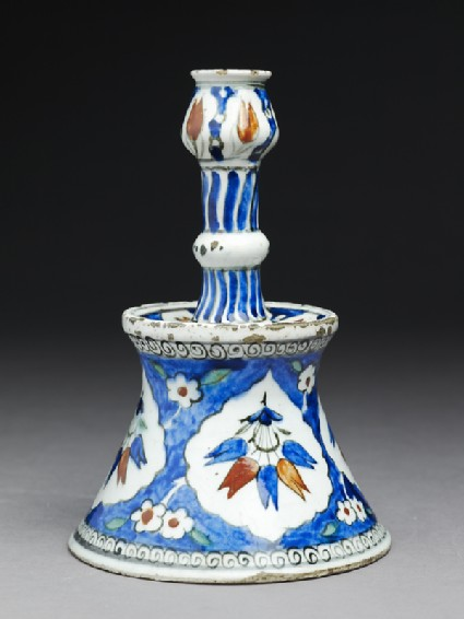 Candlestick with tulip blossomsside