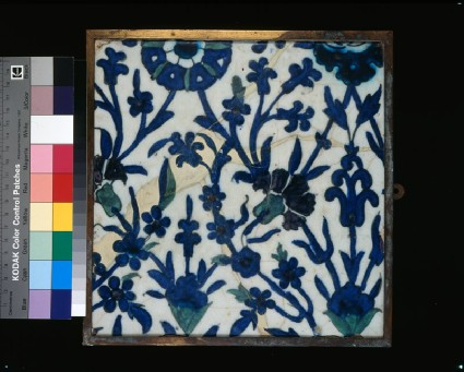 Tile with floral decorationfront