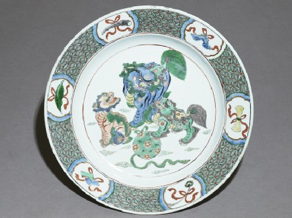 Dish with three lion dogs playing with a balltop