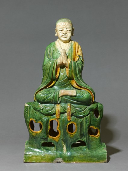 Roof ridge tile in the form of a seated Buddhist figurefront