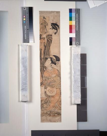 Seated courtesan being shown an ukiyo-e printfront