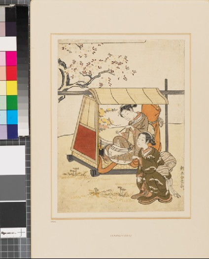 Woman resting under a cherry tree with her maidfront