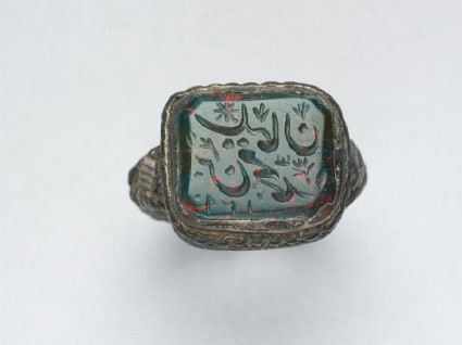 Octagonal seal ring with nasta'liq inscription, branches, and a starfront