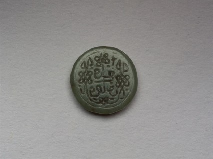 Circular bezel seal with naskhi inscription and plait decorationfront