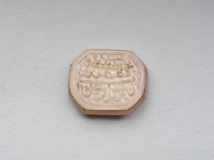Octagonal bezel seal with nasta'liq inscription and leaf decorationfront