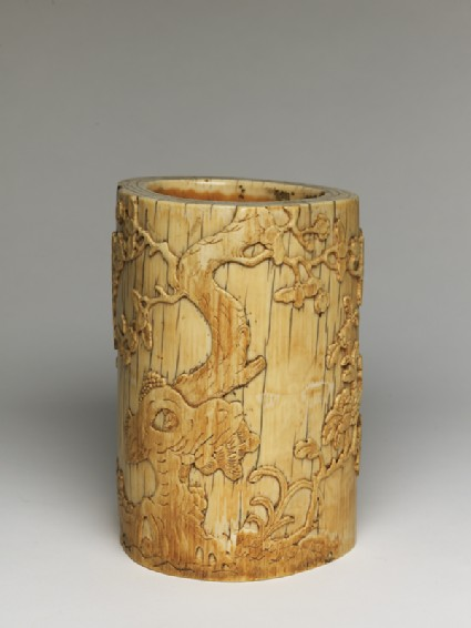 Ivory brush pot with plum blossoms and a poemoblique
