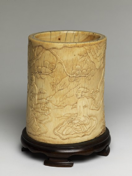 Ivory brush pot with figures in a landscapeoblique