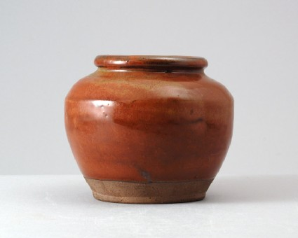 Black ware jar with russet iron glazefront
