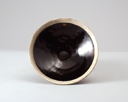 Black ware bowl with white rimfront