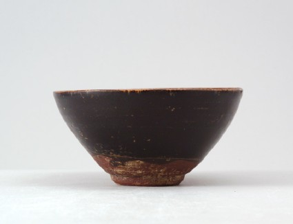 Black ware tea bowl with plum blossom decorationfront