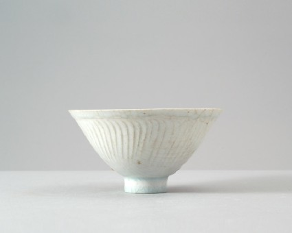 White ware bowl with three boys among foliagefront