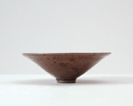 Ding type black ware bowl with russet iron glazesfront