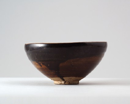 Black ware bowl with 'oil spot' glazesfront