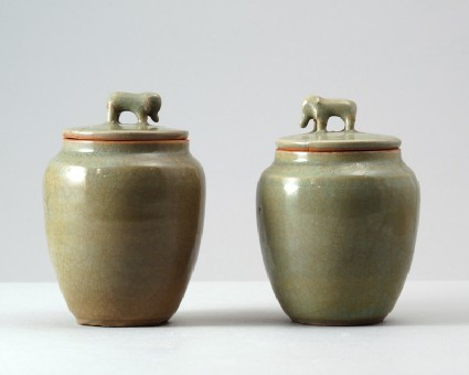 Greenware jar and lid surmounted by an elephantfront