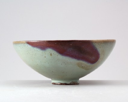 Bowl with blue glaze and purple splashesfront