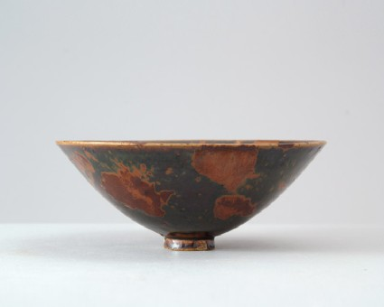 Black ware bowl with russet iron splashesfront