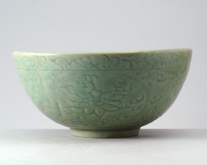 Greenware bowl with lotus flowers and wavesfront