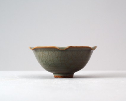 Greenware bowl with lotus leaves and a tortoisefront