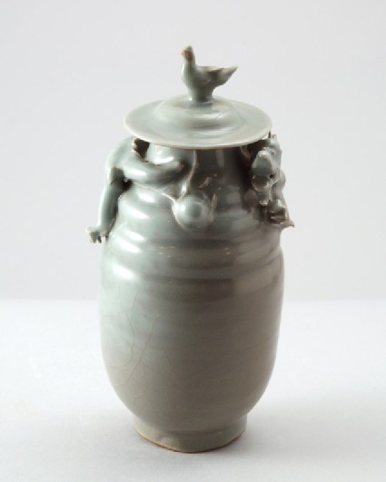 Greenware funerary jar with dragon and a birdfront
