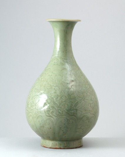 Greenware vase with floral decorationfront