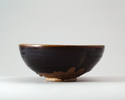 Black ware bowl with stripesfront