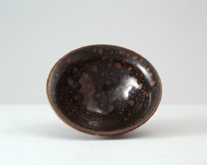 Black ware bowl with russet iron spotsfront