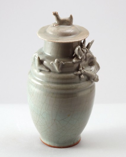 Greenware funerary jar and lid with dragon, bird, and a dogfront