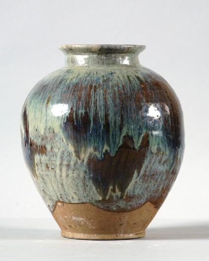 Black ware jar with blue splashesfront