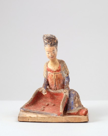 Figure of female attendant with a winnowing basketfront