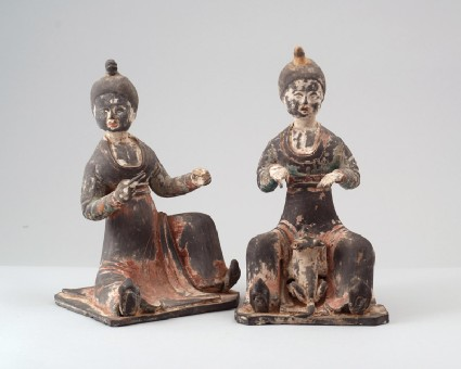 Figure of a seated female attendant with a dogfront