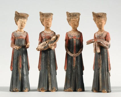 Figure of a lady holding a bale of clothfront