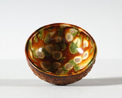 Bowl with floral decoration and a three colour glazefront