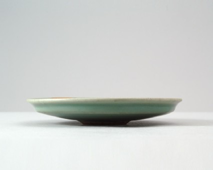 Greenware dish with dragonsfront