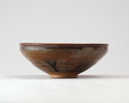 Black ware bowl with russet iron splashesfront