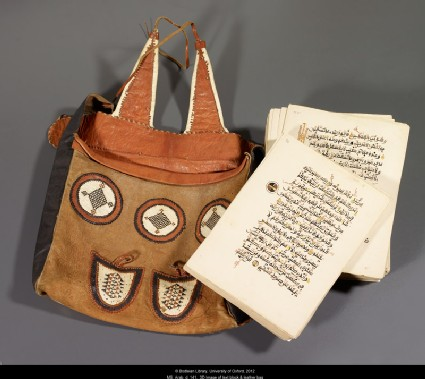 Unbound Qur'an with leather bagfront, MS. Arab.d.141, text block and leather bag